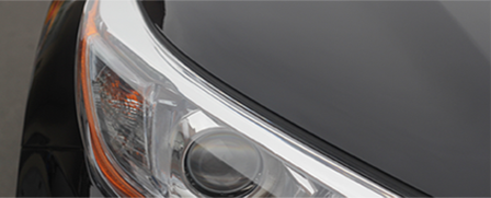 Clear and shiny headlight of a black car